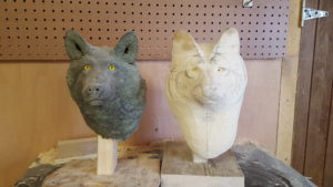 Carving a gray wolf bust.