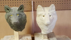 Wolf sculpture facial features being developed.