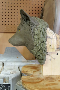 Clay Sculpture of a gray wolf